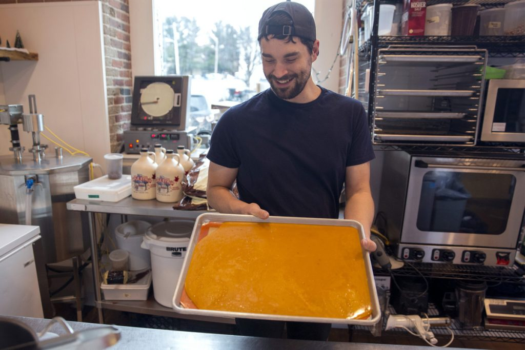 Sweetcream Dairy's Jonathan Denton holds the pepperoni toffee he made in collaboration with Biddeford's Pizza by Alex, which provided samples of its spice blend, cheese and pepperoni to help with the recipe.