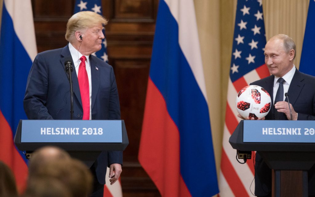 President Trump smiles while Vladimir Putin holds a soccer ball during a news conference in Helsinki, Finland, on July 16. Michael Cohen's guilty plea Thursday connected Trump's business and 2016 presidential campaign with the Russian government.
