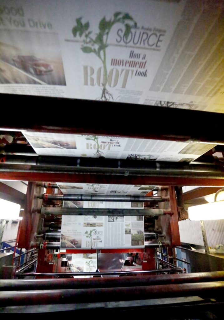 Tim Greenway/Staff Photographer The fire-engine red Flexographic press cranking out pages circa 2014.