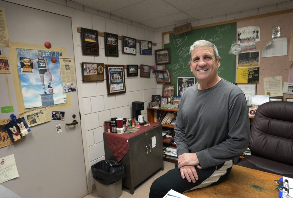 Portland High School basketball coach Joe Russo in his office. Russo was diagnosed with cancer earlier this year and has been undergoing treatments.