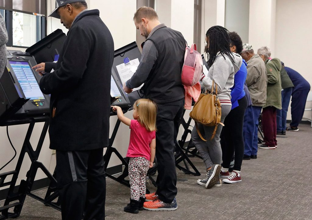 Residents cast early ballots Monday at the St. Louis County Board of Elections in St. Ann, Mo. Missouri is among the states that have had problems with their voting systems this fall.