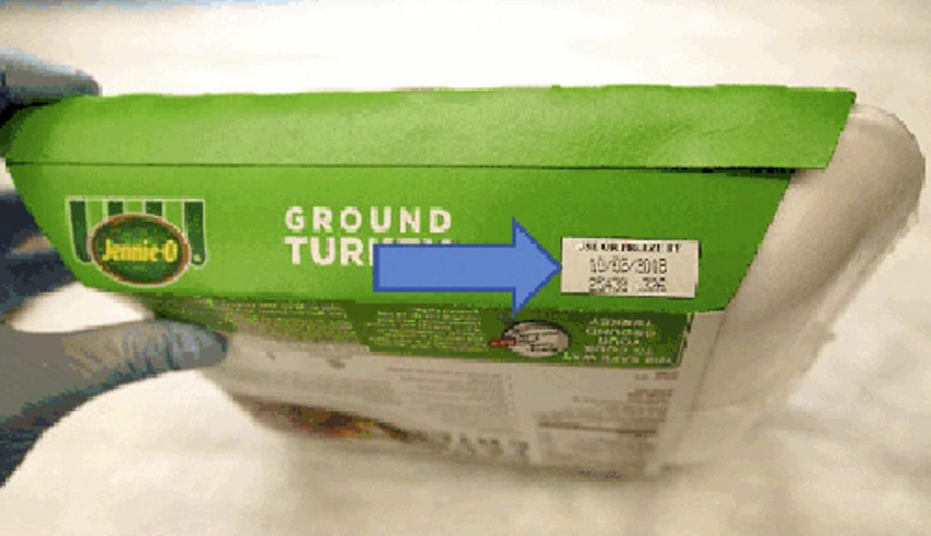 This image provided by Hormel Foods Corporation shows the production code information on the side of the sleeve of Jennie-O-Turkey that is being recalled. The products being recalled include 1-pound packages of raw, ground turkey and were shipped to retailers nationwide. Regulators say the product should be thrown away and not eaten.