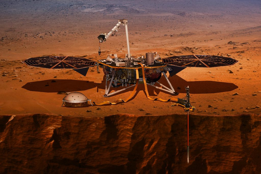 This illustration made available by NASA in 2018 shows the InSight lander drilling into the surface of Mars. InSight, short for Interior Exploration using Seismic Investigations, Geodesy and Heat Transport, is scheduled to arrive at the planet on Monday, Nov. 26, 2018.