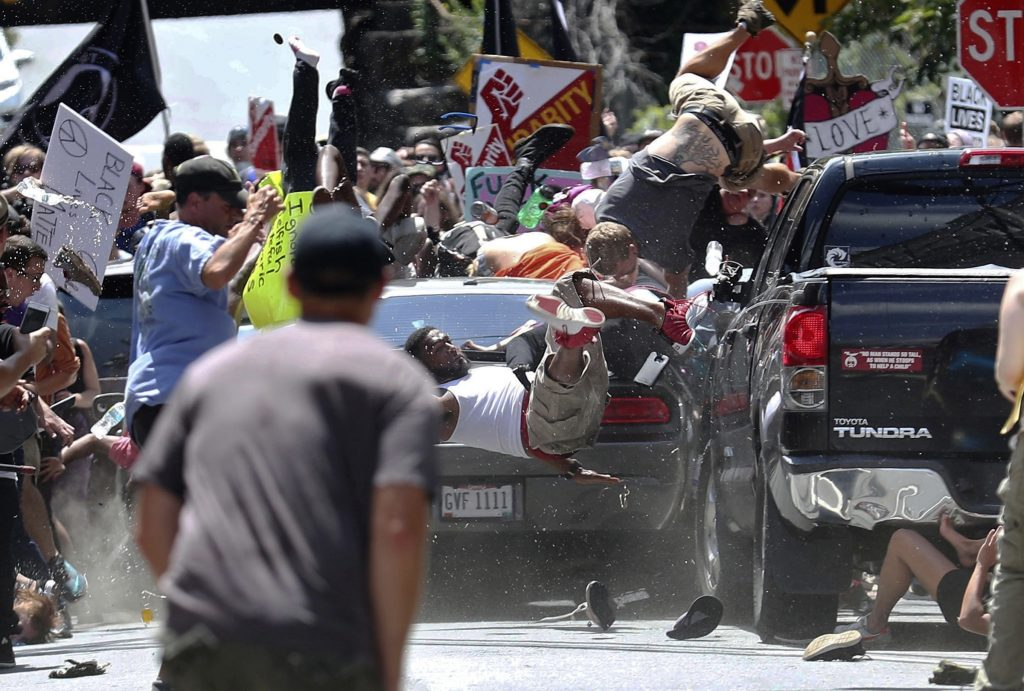 People fly into the air on Aug. 12, 2017, as a vehicle is driven into a group of protesters demonstrating against a white nationalist rally in Charlottesville, Va. James Alex Fields Jr. is accused of driving into the crowd demonstrating against a white nationalist protest, killing one person and injuring many more.