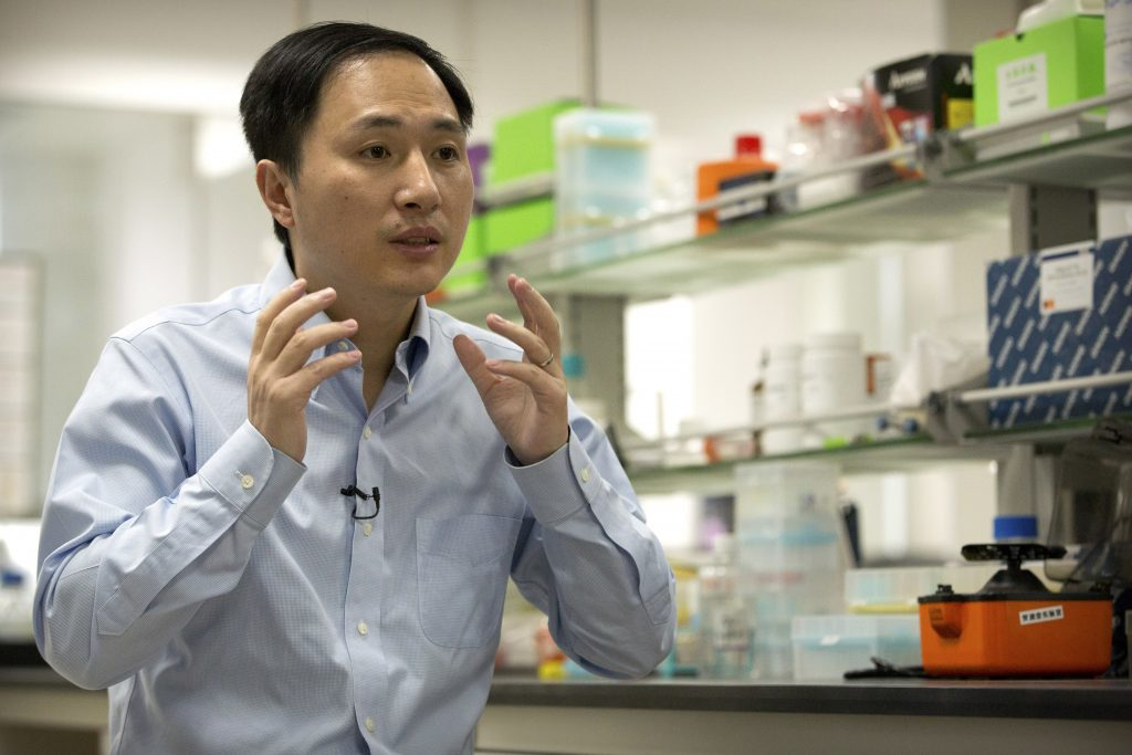 In this Oct. 10, 2018 photo, He Jiankui speaks during an interview at a laboratory in Shenzhen in southern China's Guangdong province. Chinese scientist He claims he helped make world's first genetically edited babies: twin girls whose DNA he said he altered. He revealed it Monday, Nov. 26, in Hong Kong to one of the organizers of an international conference on gene editing.
