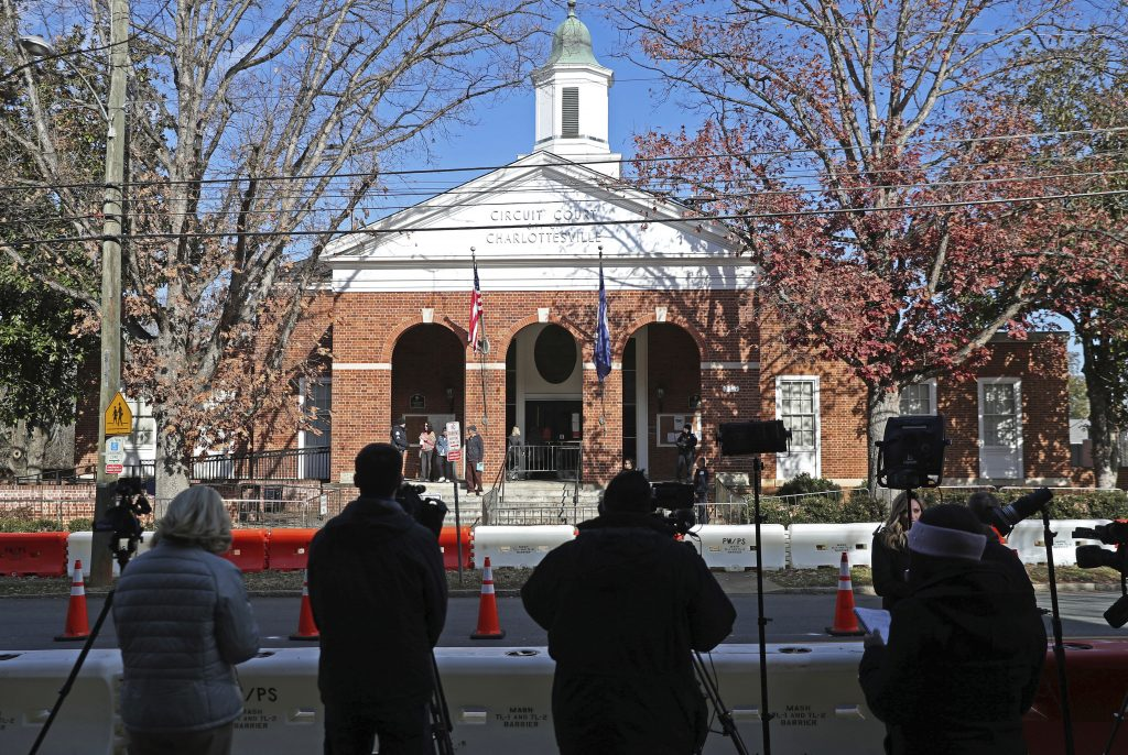 "Media wait outside the Charlottesville Circuit Courthouse during the murder trial of James A. Fields Jr.'s on Thursday in Charlottesville, Va.  Fields is charged with killing a woman and injuring dozens of counterprotesters at a ""Unite the Right"" rally in Charlottesville on Aug. 12, 2017."