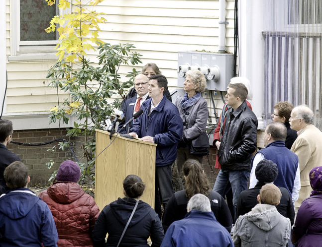 Greg Payne, director of the Maine Affordable Housing Coalition, talks about the $4 million state lead abatement program that will benefit 200 homes in Maine. Payne spoke Thursday outside an apartment building in Lewiston.