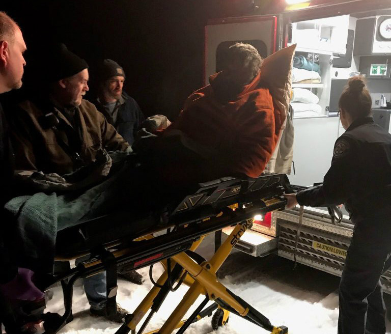 Donald Merrill is loaded into an ambulance after being rescued by game wardens on Westport Island on Nov. 19.