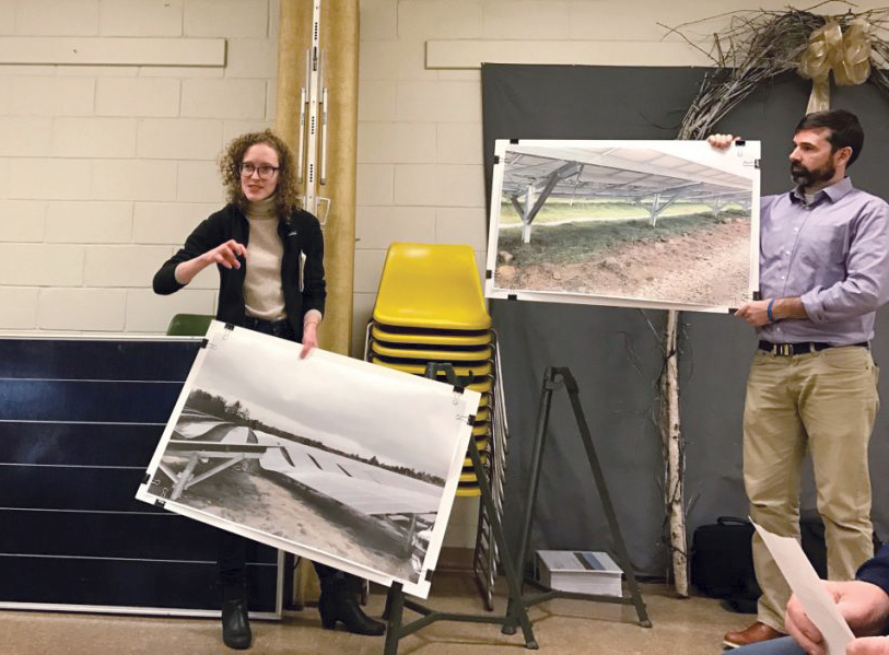 Liz Peyton and Jonathan Gravel, project managers for NextEra, present images of the company's Coolidge Solar Project in Vermont, to members of the Farmington Planning Board to illustrate what a proposed 77-megawatt project would look like. Officials with NextEra also brought a sample solar panel, pictured behind Peyton, to demonstrate what the panels used in the project would look like.