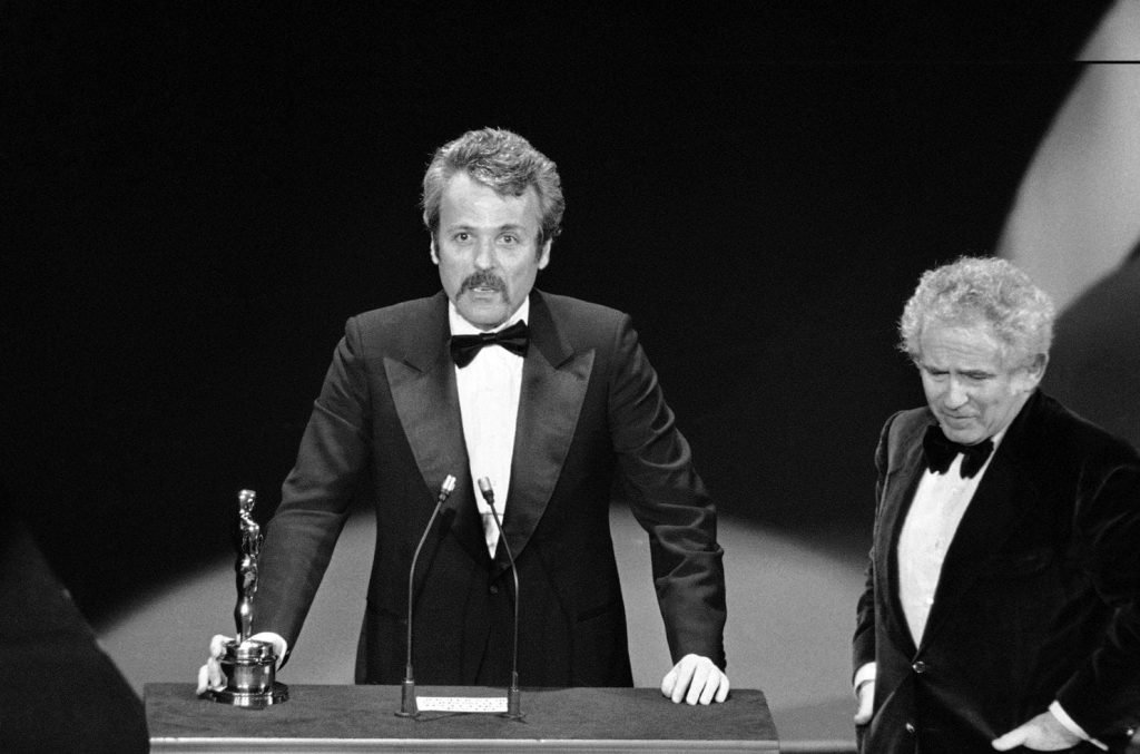 """Norman Mailer presents an Oscar to William Goldman at the 1977 Academy Awards for """"All The President's Men."""""""