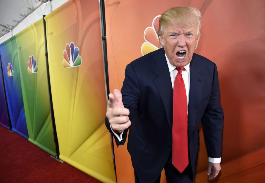 "Donald Trump, then-host of ""The Celebrity Apprentice,"" mugs for photographers at an NBC media event in Pasadena, Calif., on  June 29, 2015."