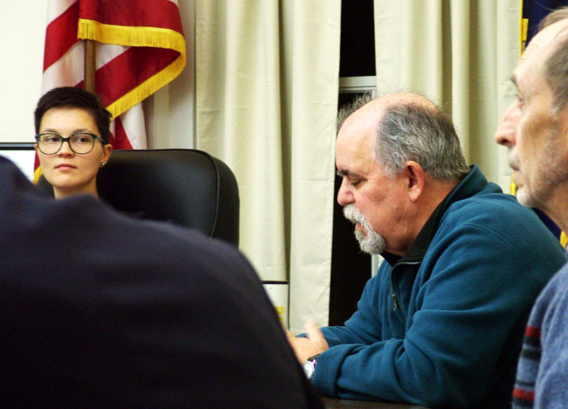 Belfast Mayor Samantha Paradis, left, and City Councilor Mike Hurley, second from right, during a meeting last month about an opinion column by Paradis that appeared in The Republican Journal.