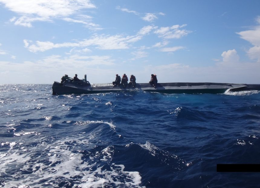 Crew members from the Coast Guard Cutter Campbell stop a suspected drug smuggling boat in the eastern Pacific Ocean during a patrol in October. During the 90-day patrol, the Campbell seized about 5,300 kilograms of cocaine, with an estimated value of $159 million, the Coast Guard says.