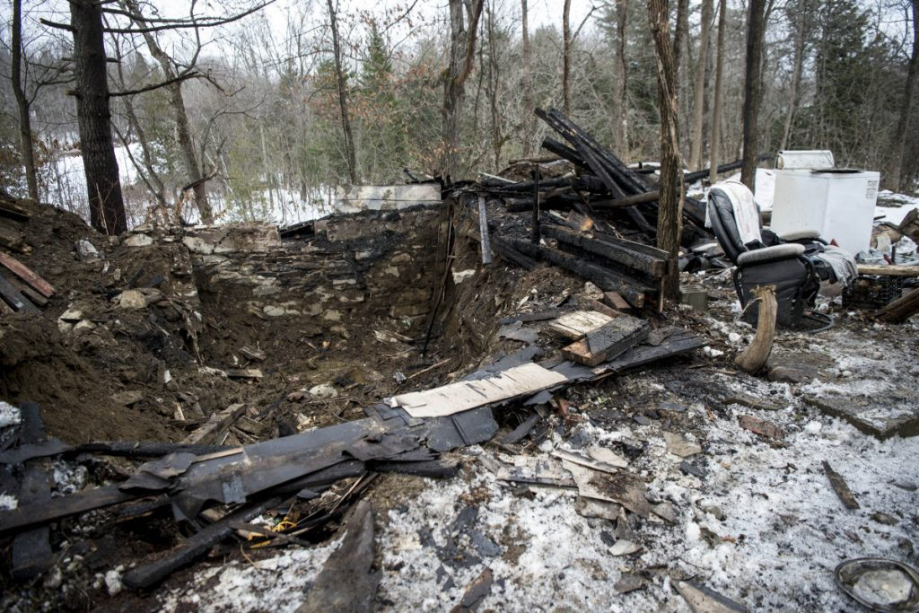 A chair and some appliances are all that remain at an abandoned house was destroyed by fire early Saturday morning on North Avenue in Skowhegan. Authorities had to excavate the remnants of the house. It is the property where law enforcement earlier this year searched for Tina Stadig, who remains missing.