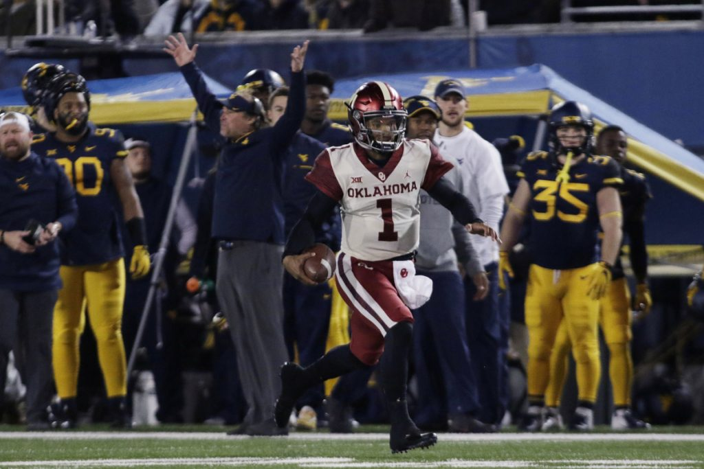 Oklahoma quarterback Kyler Murray (1) runs the ball for a touchdown during the first half against West Virginia on Nov. 23 in Morgantown, West Virginia.