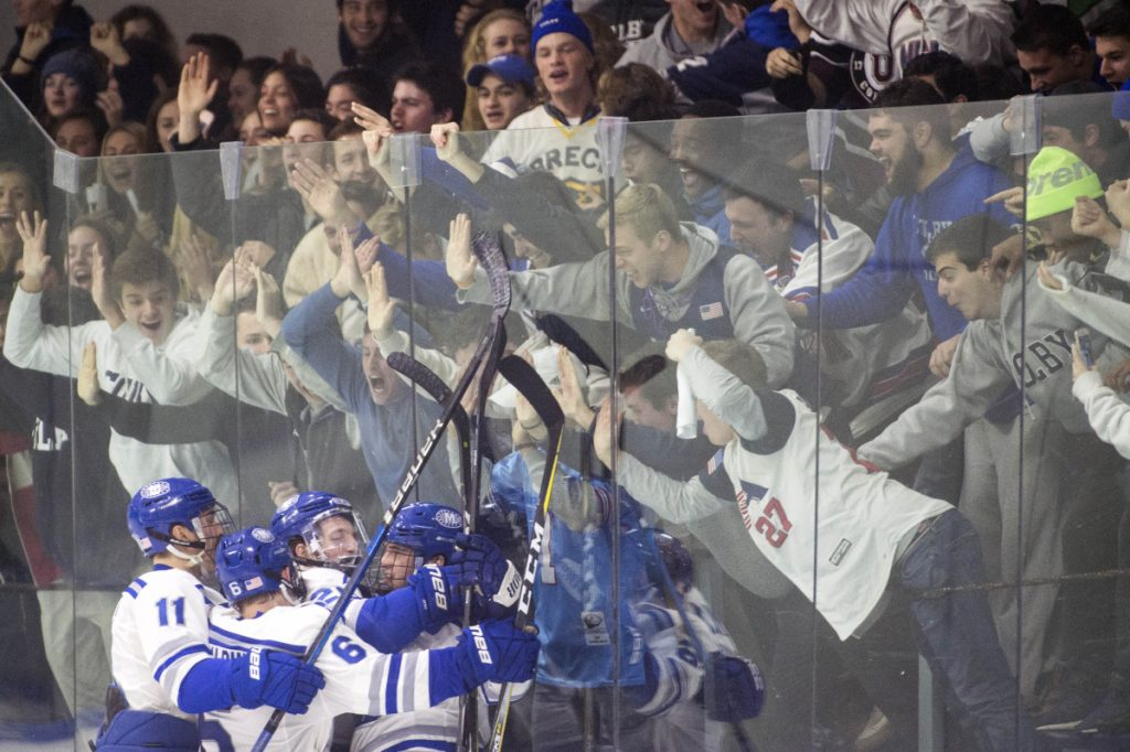 Members of the Colby College hockey team celebrate Michael Morriseey's second-period goal in a 3-3 tie against rival Bowdoin College on Saturday night at Alfond Rink in Waterville,