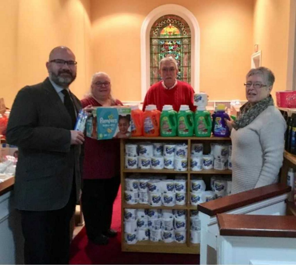 Mark Wilson, pastor, left, with Gail Morris, Carl Daiker and Lora Downing organize items and volunteer in the Essentials Closet located at the First Congregational Church, Eustis Parkway in Waterville.