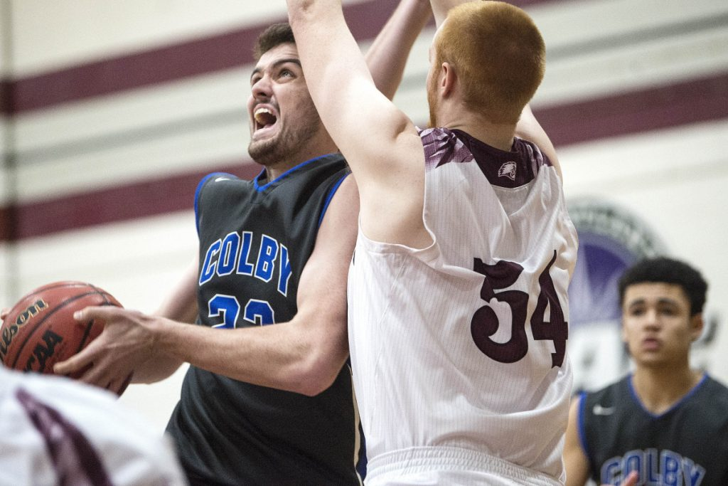 University of Maine at Farmington's Anthony Owens (54) defends Colby's Sean Gilmore on Tuesday in Farmington.