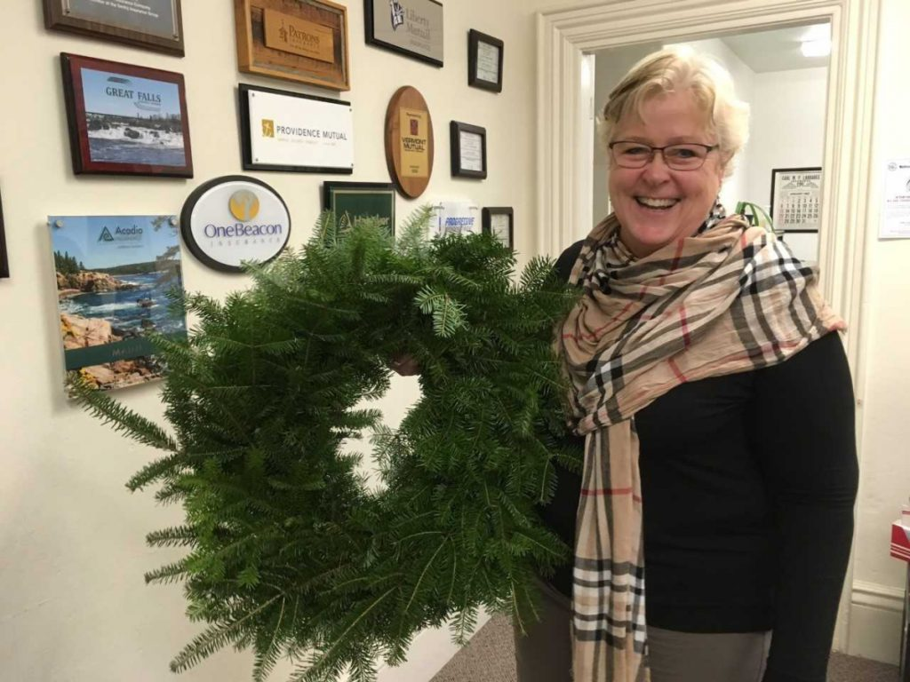 "Sheila Sawyer from Carl Larrabee Insurance Agency was in the holiday spirit when she received her wreath to decorate for Wreaths Around the Holidays, a display at Wiscasset Holiday Marketfest. She's already tapped an office mate to help with the decorating. For a calendar of marketfest activities, visit <a href=""http://www.wiscassetholidaymarketfest.com"">www.wiscassetholidaymarketfest.com</a>."