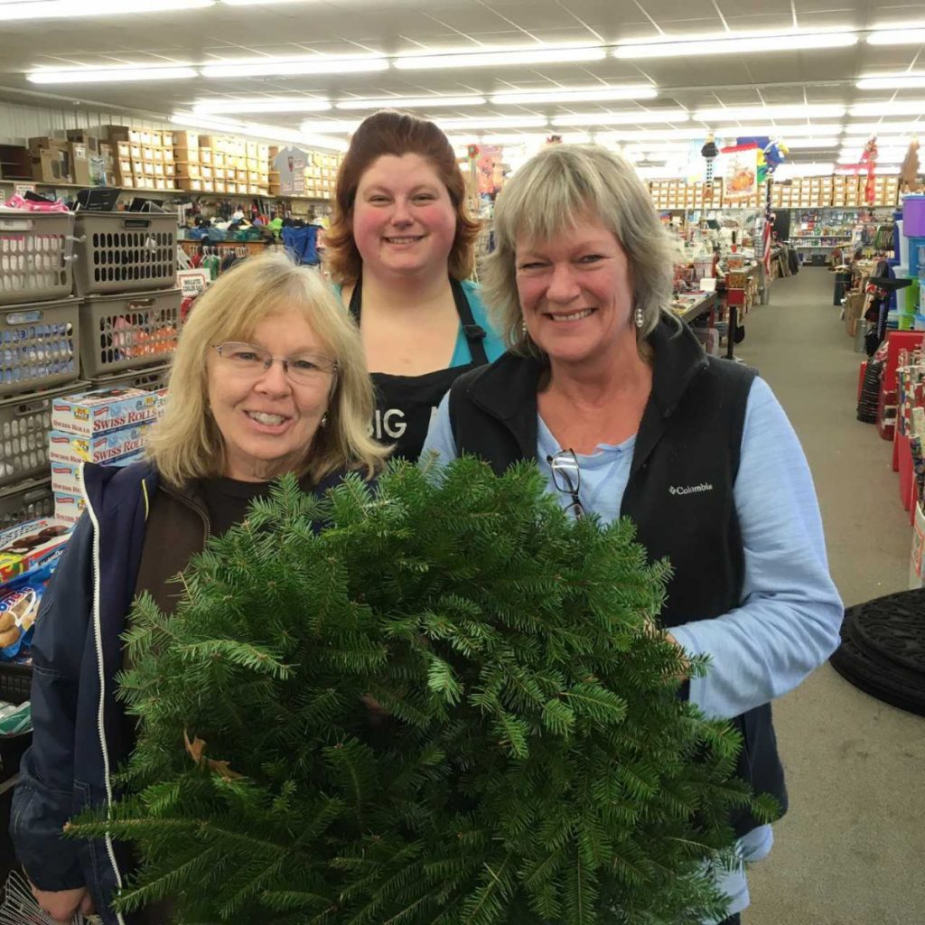 The Big Al's crew of Melissa Cohen, left, with Rose Baile, and Marian Cromwell, received an empty wreath to  decorate for display at Wiscasset Holiday Marketfest. Nine additional Wiscasset Area Chamber of Commerce business members are decorating wreaths for the event. Wreaths will be donated to local families after Marketfest which runs from Thursday through Sunday, Dec. 6-9.