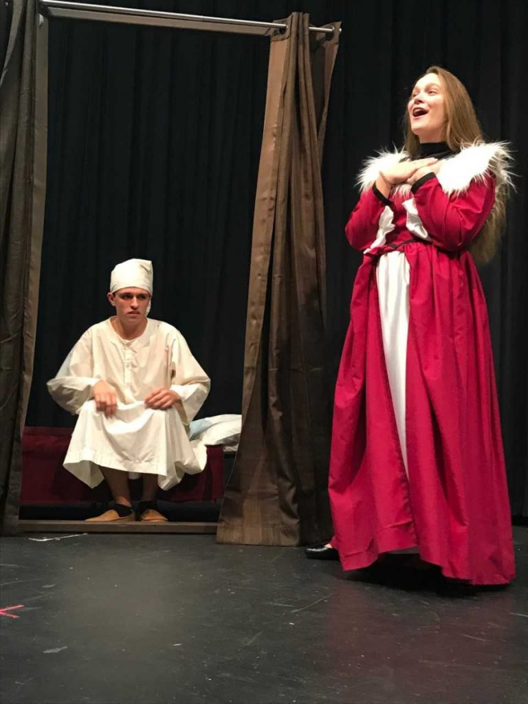 James Greenwood, left, as Ebeneezer Scrooge and Katie Daigle as the Ghost of Christmas Present.
