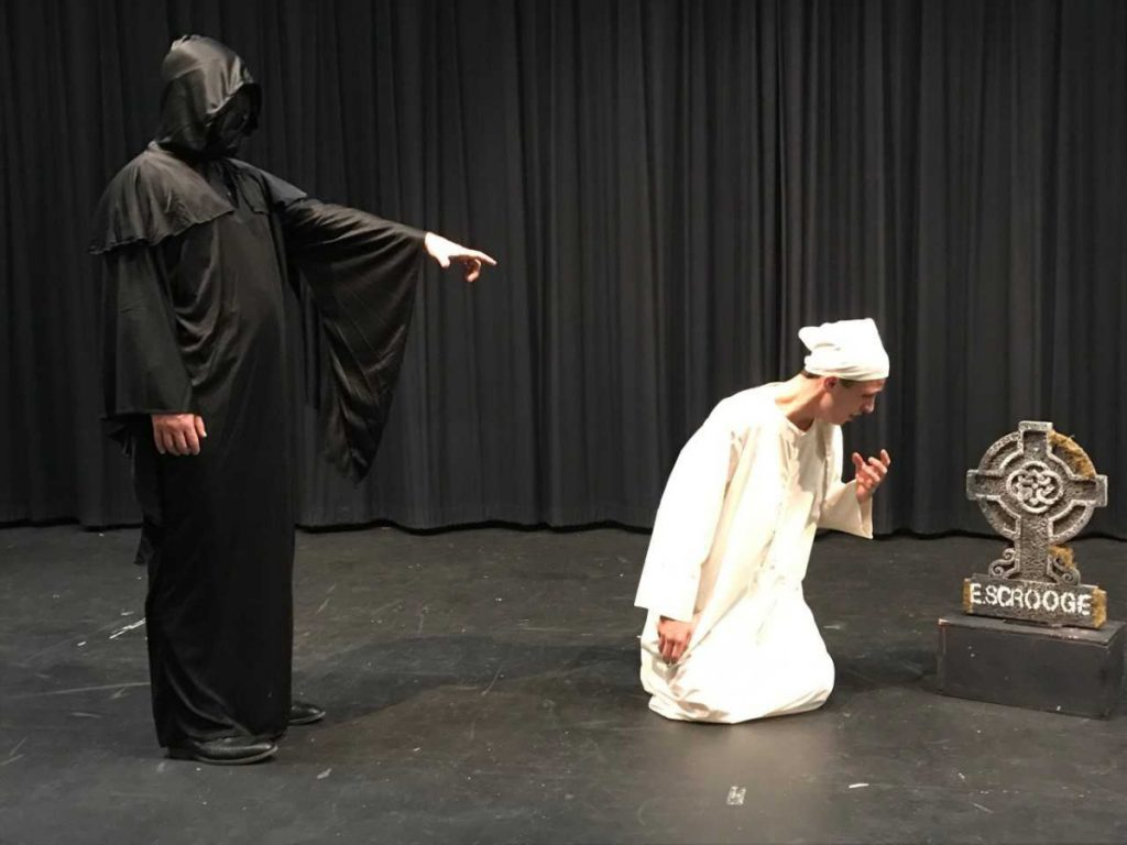 Marco Aliberti, left, principal at Oak Hill High School, as the Ghost of Christmas Future, and James Greenwood as Ebeneezer Scrooge.