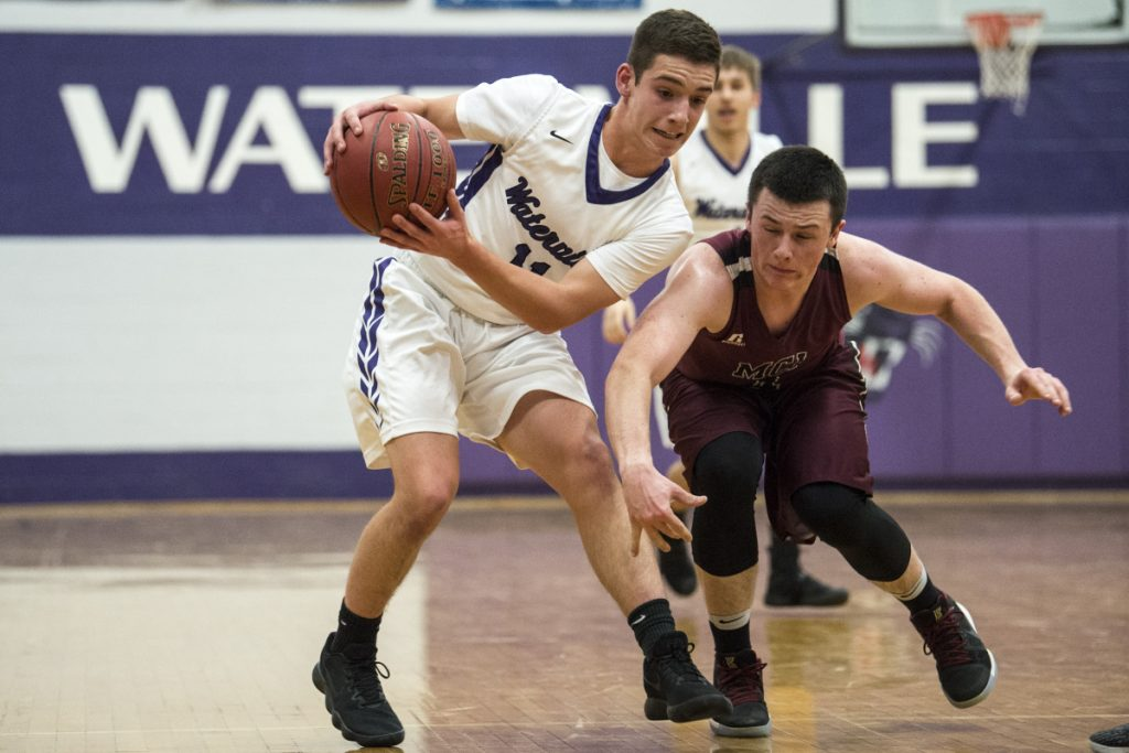 Preventative measure: Waterville's Ben Danner, left, grabs the ball as Maine Central Institute defender Owen Williams closes in during a game last season in Waterville.