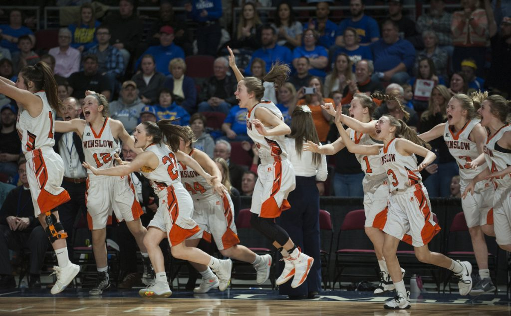 The Winslow girls basketball team celebrates after it beat Lake Region 43-29 in the Class B state championship game last year at the Cross Insurance Center in Bangor.