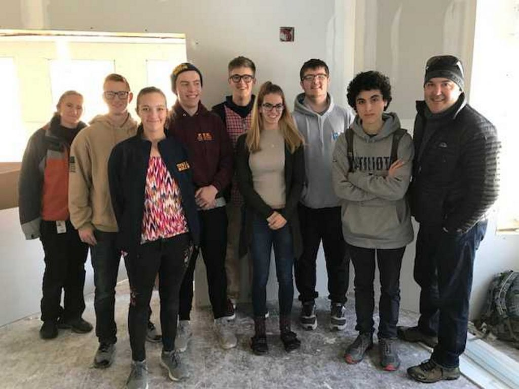 Taking part in the design and building of the interactive sand table exhibit from left are Caitlin Hanlon, Ed Tech; Tyson Hill, Katie Holmes, Noah Bell, Colin Hutchins, Bradie Reynolds, Connor Damon, Sebastian Fournier and Jake Bogar, teacher.