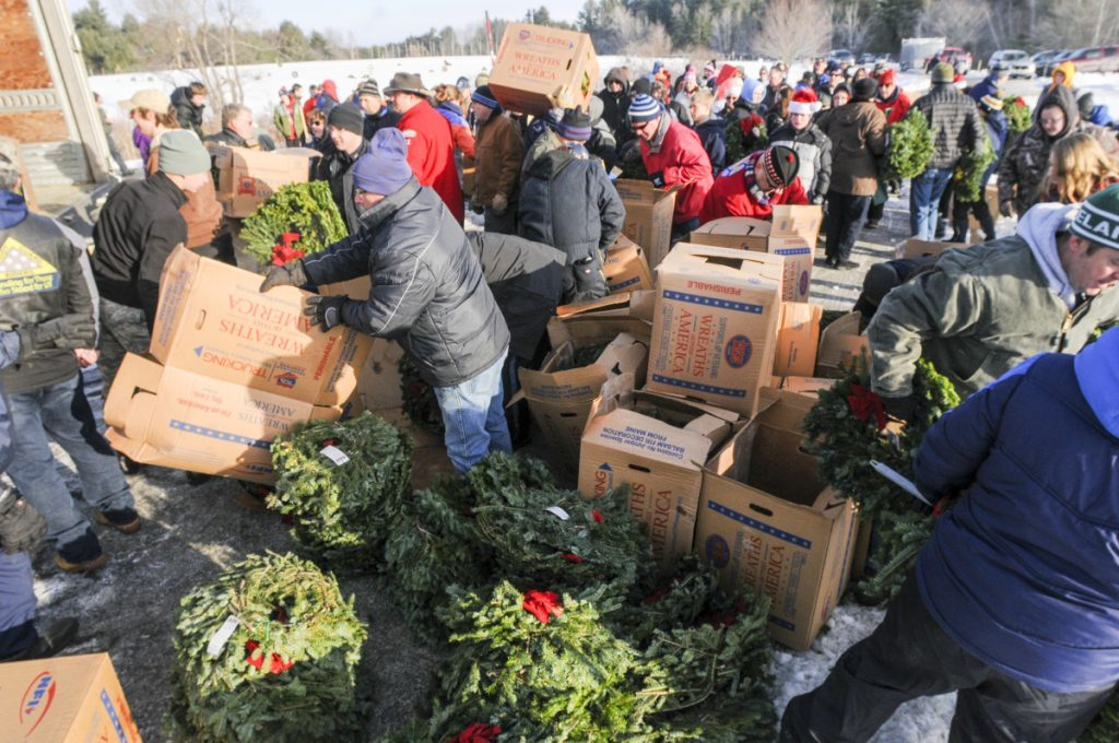 Volunteers unload wreaths Dec. 16, 2017, at the start of the first of three Wreaths Across America events, at the Maine Veterans Memorial Cemetery on Mount Vernon Road in Augusta. On Sunday, a convoy of trucks carrying Maine-made wreaths to Arlington National Cemetery as part of the ceremonies will stop in Augusta for a rally to show appreciation for veterans.