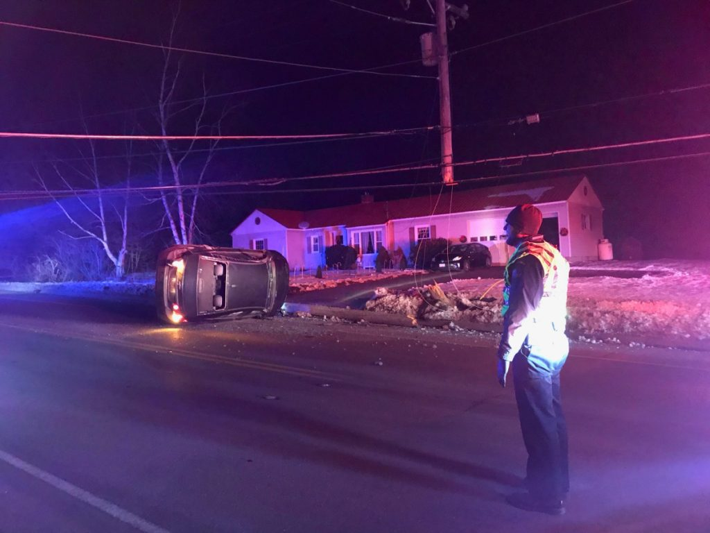 Waterville police and firefighters arrived at the scene Friday evening on Main Street after a car struck a telephone pole and rolled over.