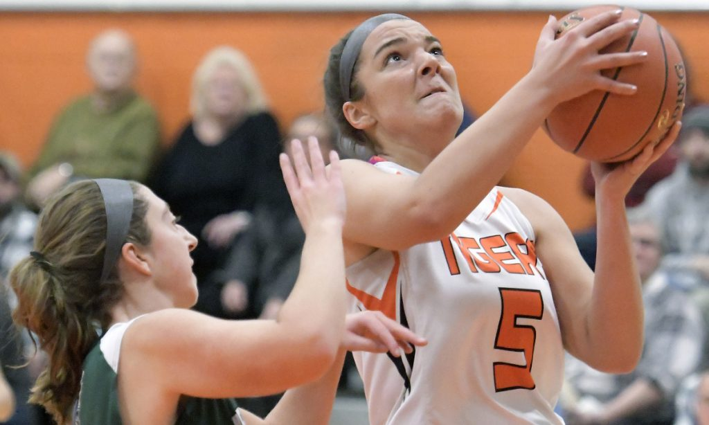 Gardiner's Anna Toman, right, goes up for for a basket in front of Leavitt's McKenna Redstone on Tuesday in Gardiner.