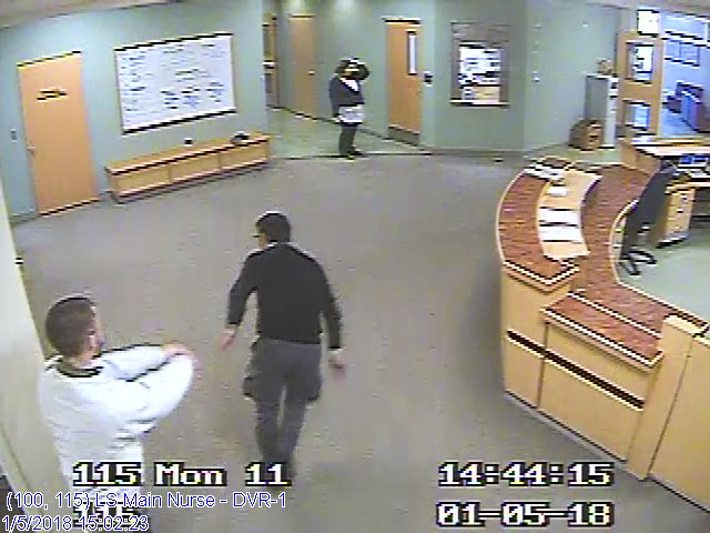 "This still shot from Riverview Psychiatric Center video surveillance system footage shows Ahmad Khansari Nejad being shoved in the back Jan. 5 by ""Patient W"" on the hospital's Lower Saco forensic unit. Several clips from the video were played in court."