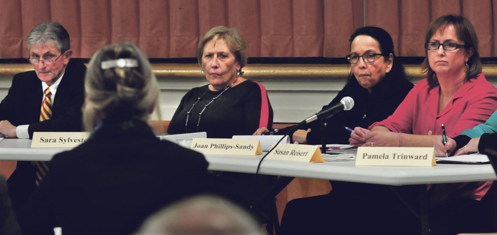 Waterville school board member Susan Reisert, right, takes part on Nov. 16, 2015, in a dismissal hearing about then-Waterville Senior High School Principal Don Reiter. Reisert has announced that she has  resigning from her board seat. Also pictured, Attorney Melissa Hewey, facing away, speaks with attorney Bryan Dench. Sitting with Dench, from left, are Waterville Board of Education Chairman Sara Sylvester and member Joan Phillips-Sandy.