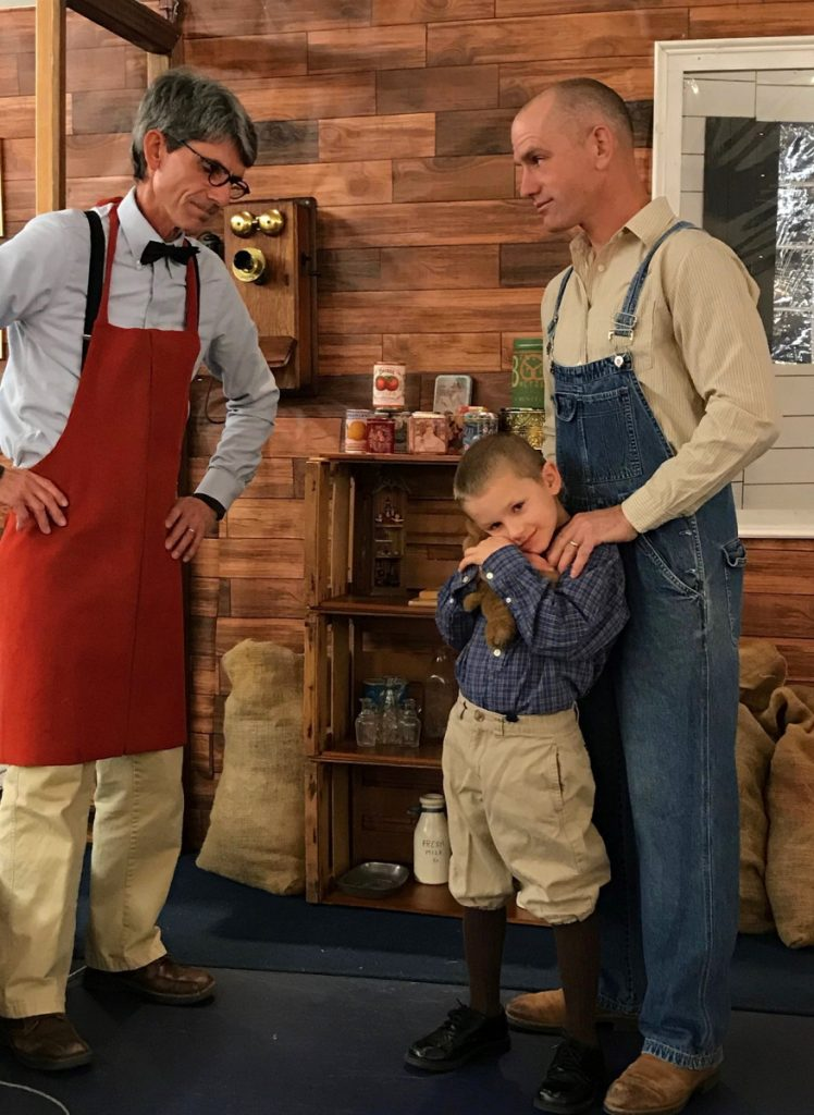 """Shopkeeper, Mr. Willaby (John Trabucchi), left, with Joey (Elijah Phillips) and his father, Kyle (Chris Phillips) in a scene from """"Sing Merry Christmas!"""" an original musical set during the Great Depression. The production will be presented 7 p.m. Sunday and Monday, Dec. 16-17, by New Hope Baptist Church at 268 Perham St., in Farmington. Admission is free. Snow date is Tuesday, Dec. 18."""