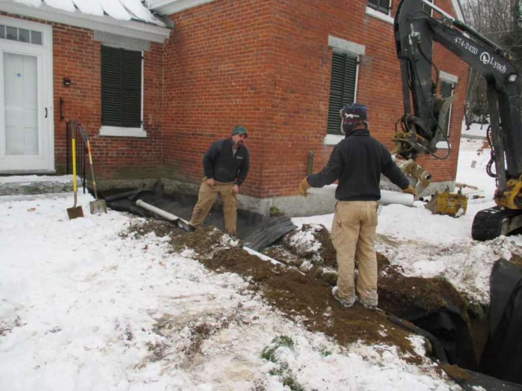 French drains were installed in November by Lynch Landscaping workers Jorden Burdet, left, and Gage Currie.