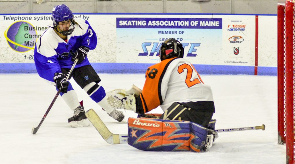 Winslow/Gardiner/Cony goalie Gabriella Chambers blocks a shot by Lewiston's Paige Pomerlea, left, during a game earlier this season at the Camden National Bank Ice Vault in Hallowell. Winslow/Gardiner will play Yarmouth/Freeport in the regional quarterfinals on Wednesday.