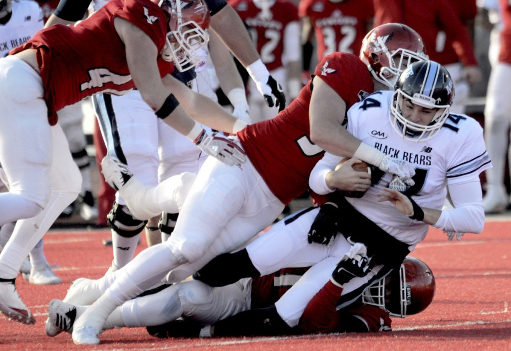 Eastern Washington's Mitchell Johnson (94) and Jonah Jordan (91) sack Maine quarterback Chris Ferguson during the first half of an FCS semifinal Saturday in Cheney, Washington.