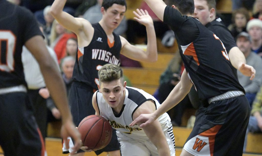 Maranacook's Mitchell Root finds his way under Winslow defenders during a Kennebec Valley Athletic Conference game Tuesday in Readfield.