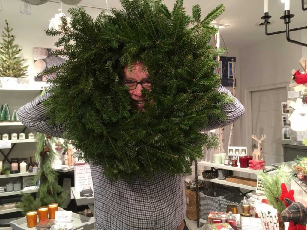 BIRCH Home Furnishings and Gifts co-owner Brad Sevaldson jumps right in when presented with his bare wreath ready for decorating as part of Wiscasset Holiday Marketfest's Wreaths Around the Holidays. Wreaths were on display in the Nickels-Sortwell barn Dec. 7-9.