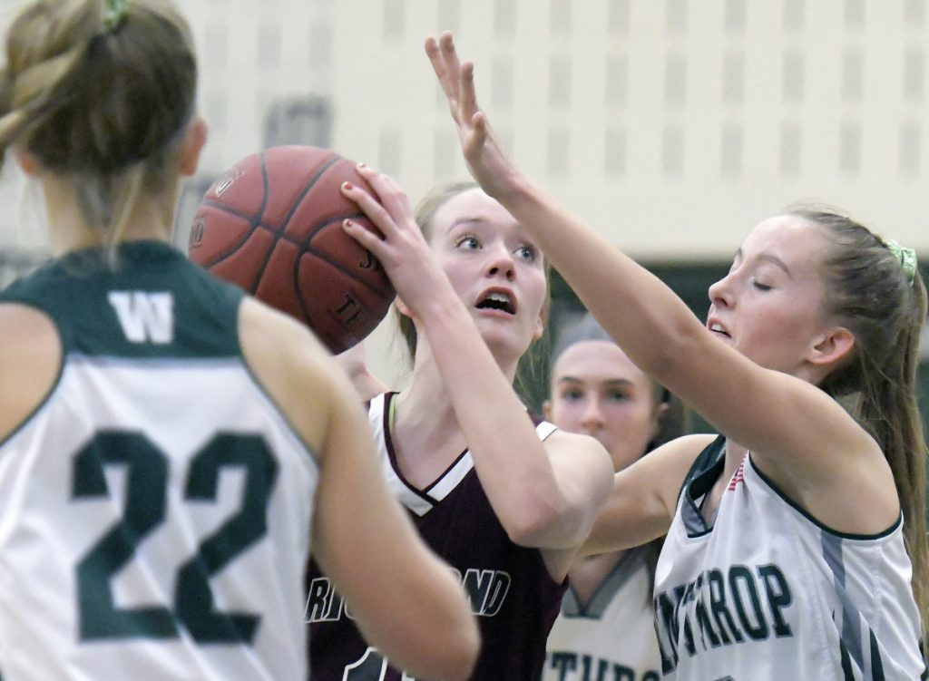 Winthrop's Madison Forgue guards Richmond's Hannah Moholland during a Mountain Valley Conference game Wednesday in Winthrop.