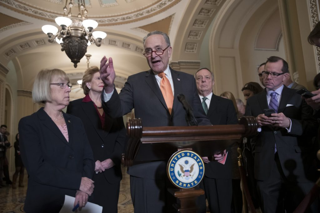 Senate Minority Leader Chuck Schumer, D-N.Y., Sen. Patty Murray, D-Wash., Sen. Debbie Stabenow, D-Mich., and Sen. Dick Durbin, D-Ill., the assistant Democratic leader, talks to reporters about the possibility of a partial government shutdown, at the Capitol in Washington on Tuesday. Senators passed measure to keep government running to Feb. 8, by voice vote without a roll call.