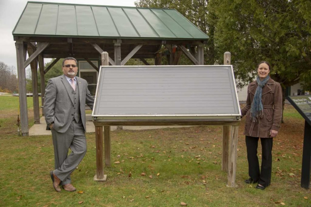 Unity College President Dr. Melik Peter Khoury, left, and Chief Sustainability Officer Jennifer deHart, stand next to one of the College's Jimmy Carter solar panels that the former president placed on the White House during his time in office. Two of the panels are featured in the largest exhibition ever about the Sun at the Science Museum in London.