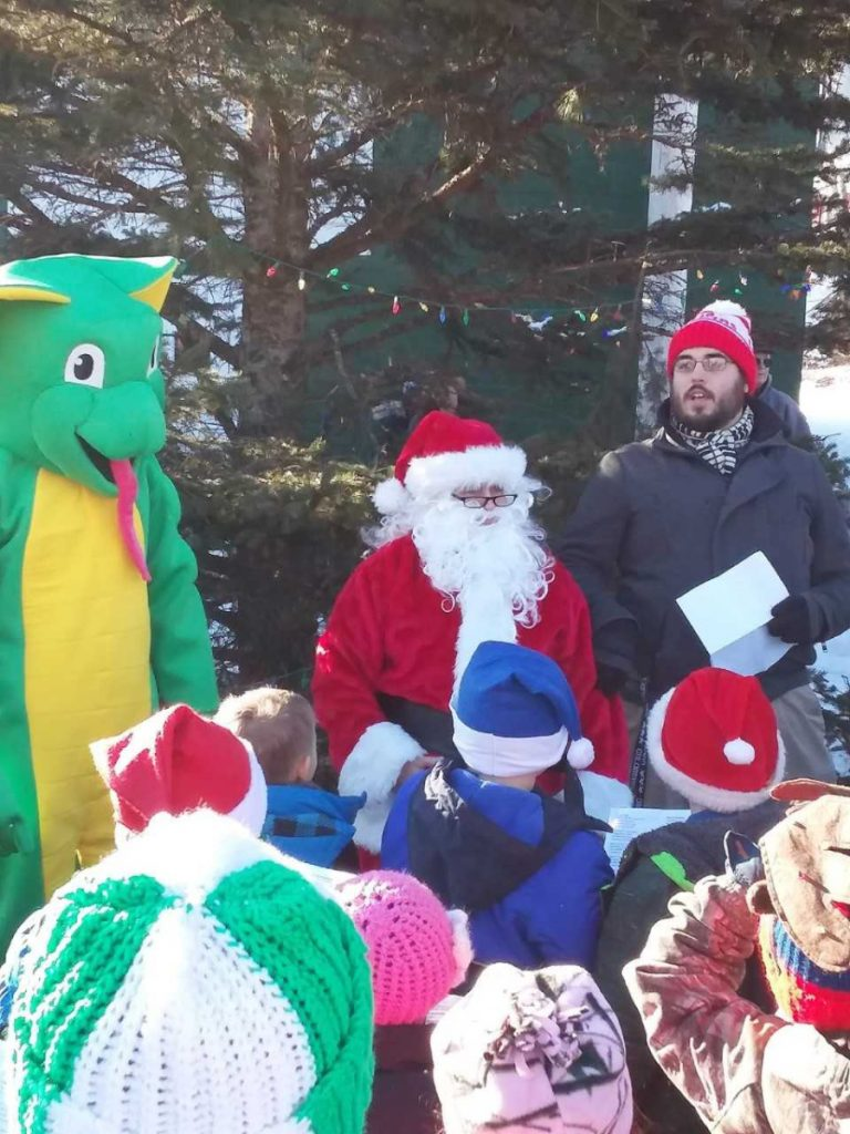 Carrabec Community School staff and students walked to the North Anson Fire Department on Wednesday, Dec. 19, and sang Christmas carols around the Christmas tree. From left is the school's Carrabec Cobra mascot, Santa Claus and Music Teacher Mr. Dan Gilbert.