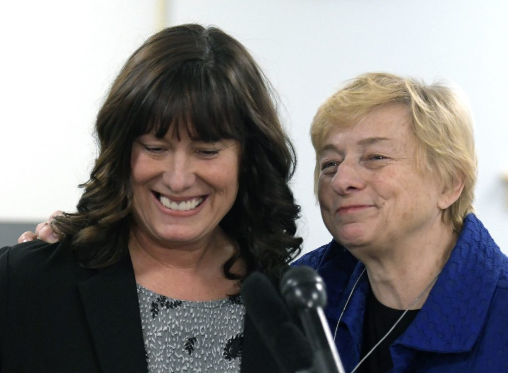 Pender Makin, of Scarborough, speaks Wednesday with Gov.-elect Janet Mills in Augusta. Makin, who currently serves as assistant superintendent Brunswick School Department, was nominated to serve as commissioner of the Department of Education.