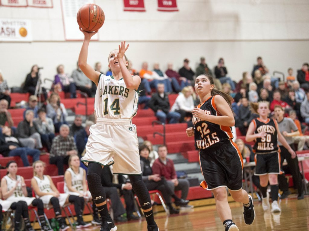 Rangeley's Emily Eastlack (14) goes in for the easy layup against Forest Hills on Saturday at Cony High School in Augusta.