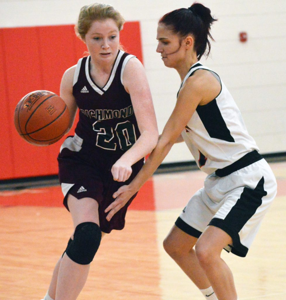 Times Record photo by Bob Conn   Richmond's Bryanne Lancaster (20) looks to drive past the defense of Lisbon's Sydney Plourde during Saturday's MVC game Saturday in Lisbon.
