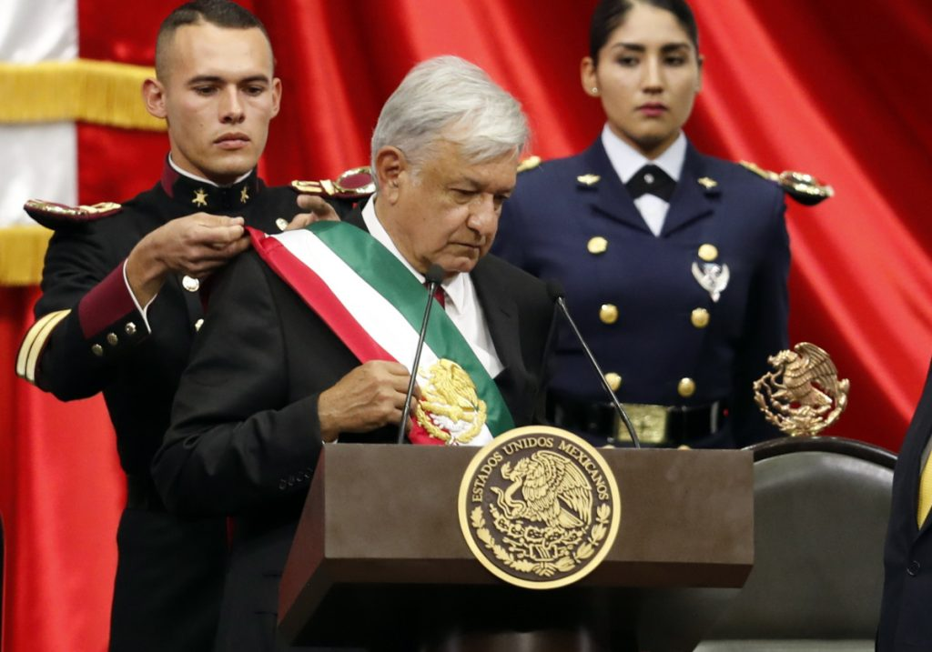 Mexico's new President Andres Manuel Lopez Obrador receives the presidential sash during the inaugural ceremony Saturday in Mexico City.