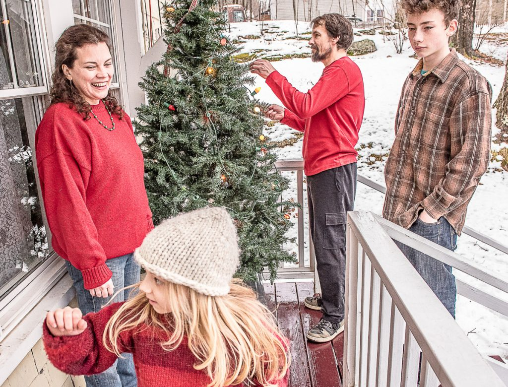 Though besieged with health and financial problems, Auburn couple D'Arcy Ames and Gary Couture and their children, Vivian and Calvin, still can find reason for holiday cheer.
