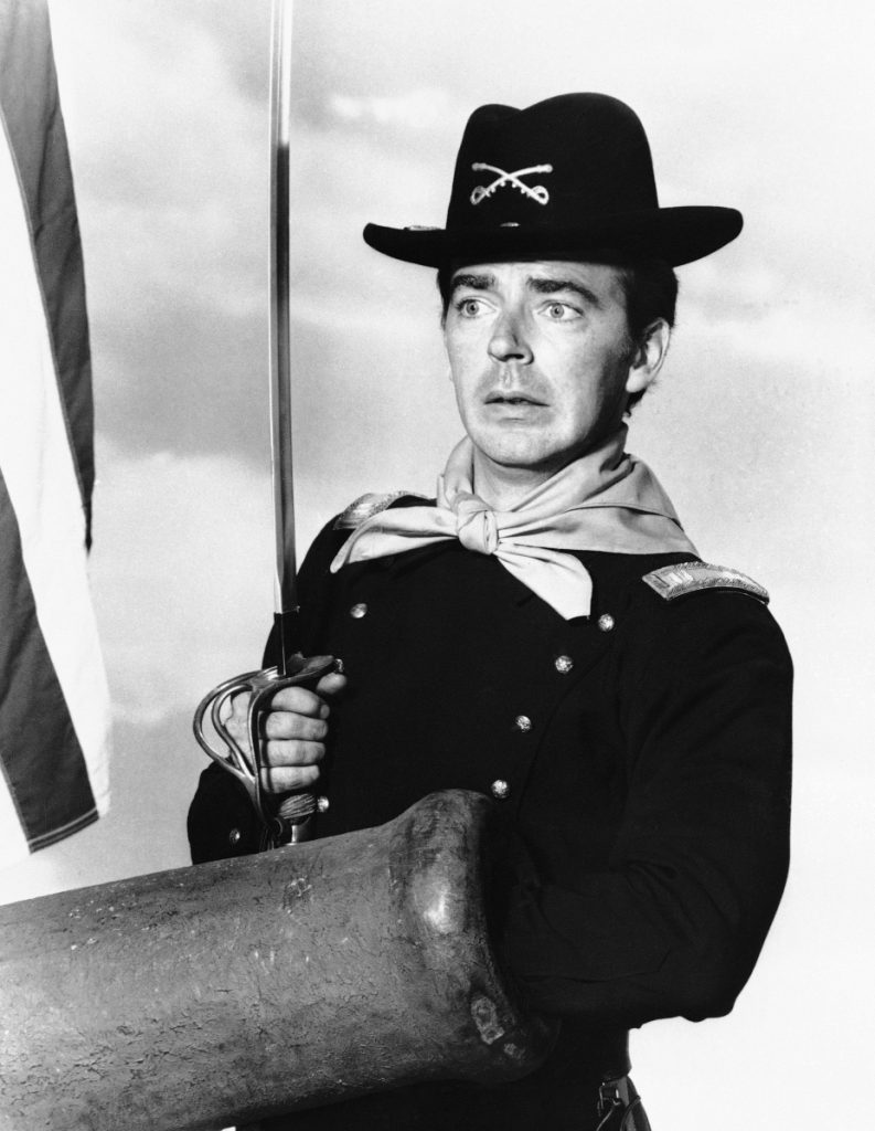 "Ken Berry, playing Capt. Wilton Parmenter, reaches down the wrong end of cannon in a 1965 episode of the TV series ""F Troop."" A spokeswoman at Providence St. Joseph in Burbank, Calif., confirmed Berry died Saturday. He was 85. (Associated Press)"